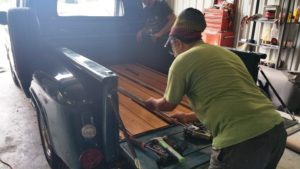 putting wood in truck bed