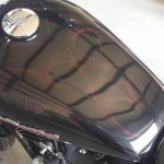 custom motorcycle paint job with red ghost flames