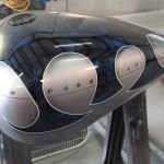 two tone custom motorcyle paint job with tribal flames, marble effect and a cut steel look