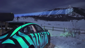 racing extinction car in colorado with electroluminescent paint
